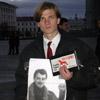 Участник акции протеста 20 ноября.[Нажмите для увеличения]