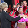 Belarusian Deputy Sports Minister Zaburianova is awarding the Belarusian team that held the 7th place at the world championship of sports dancing. [Press for large view]